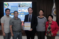 Dr Raymond Cheng receiving Certificate of Appreciation from NEUST-UNP officials
